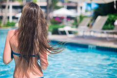 Young woman enjoying vacation in the pool Royalty Free Stock Photography