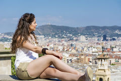 Young woman enjoying the view  in Barcelona,Spain. Tourist young woman looking the view of Barcelona Stock Photos