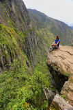 Young woman enjoying the view of Inca Bridge and cliff path near Royalty Free Stock Image