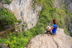 Young woman enjoying the view of Inca Bridge and cliff path near Royalty Free Stock Photography