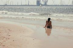 Young Woman Enjoying View At Ocean Stock Photos