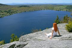Young woman enjoying the view over lake Royalty Free Stock Images