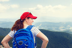 Young woman enjoying view from the top of mountain Stock Image