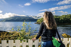 Young woman enjoying the views of Norway Stock Photography