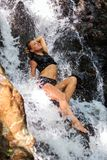 Young woman enjoying waterfall freshness Royalty Free Stock Photos