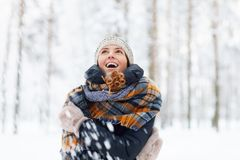 Young Woman Enjoying Winter. Waist up portrait of beautiful young woman in winter forest having fun and enjoying snow, copy space royalty free stock images