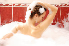 Young woman enjoys bath-foam Stock Photos