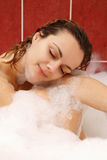 Young woman enjoys bath-foam Royalty Free Stock Photography