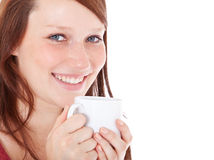 Young woman enjoys cup of coffee Stock Photos