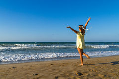 Young woman enjoys her time on a  beach at dusk Royalty Free Stock Photo