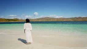 Young woman enjoys Labuan Bajo beach view stock images