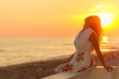 Young woman enjoys relaxing at the seaside Stock Photo
