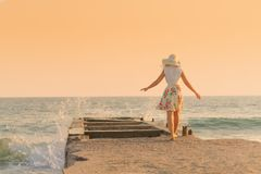 woman enjoys relaxing at the seaside at sunset Royalty Free Stock Photos