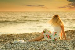 Young woman enjoys relaxing at the seaside Royalty Free Stock Photography