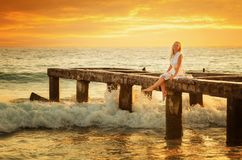 Young woman enjoys relaxing at the seaside Royalty Free Stock Image