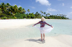 Young woman enjoys the serenity of a deserted tropical island Royalty Free Stock Image