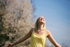 Young woman enjoys sunshine Stock Photos