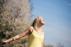 Young woman enjoys sunshine Stock Photography