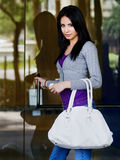 Young woman entering building doorway Stock Photos