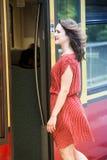 Young woman entering a train wagon Stock Photos