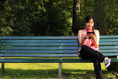 A young woman with an ereader Stock Photos