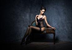 Young woman in erotic lingerie in a studio Royalty Free Stock Photography