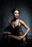 Young woman in erotic lingerie in a studio Royalty Free Stock Image
