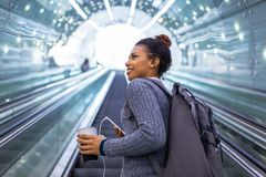 Young woman on subway escalator Stock Photography