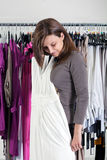 Young woman essaying clothes Stock Image