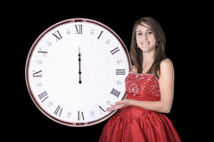 Young woman in evening dress with midnight clock Stock Photos