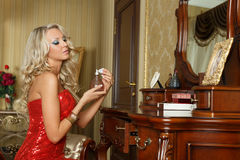 Young woman in evening dress with perfume. Stock Image