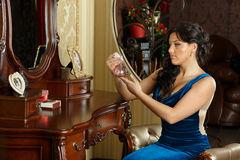 Young woman in evening dress with perfume. Royalty Free Stock Photos