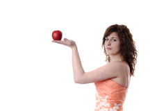 Young woman in evening dress presenting an apple Stock Image
