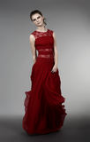 Young woman in evening dress. Young woman in red evening dress Stock Photography