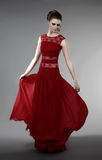 Young woman in evening dress. Young woman in red evening dress Stock Photo