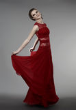 Young woman in evening dress. Young woman in red evening dress Stock Image