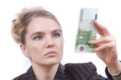 Young woman examine money. Young woman giving 100 Euro on white background Stock Photo