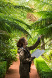 Young woman examine Silver Fern Stock Photography