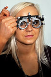 Young woman examining the eyesight Stock Photo