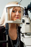 Young woman examining the eyesight Stock Image