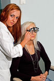 Young woman examining the eyesight Stock Photography