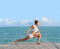 Young woman excercising on the seaside Stock Photography