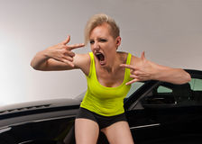 Young woman excited about her new car stock image