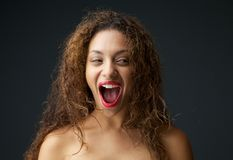 Young woman excited and laughing with open mouth Royalty Free Stock Images