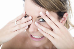 Young Woman Excited Peeping Through Fingers Royalty Free Stock Photo