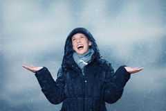 Young woman is excited about the snowfall Royalty Free Stock Photography