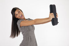 Young Woman Excitedly Holding Out a Laptop Case Stock Image