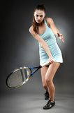 Young woman executing a forehand Royalty Free Stock Photos