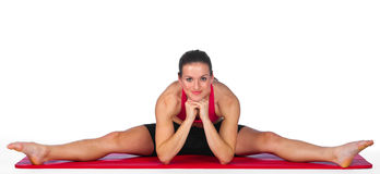 Young woman exercise. Attractive woman stretching on the mat Stock Photo