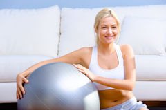 Young Woman with Exercise Ball royalty free stock image